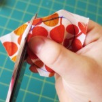 cutting fabric circles to make a fabric covered button