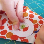 cutting the template for a fabric covered button