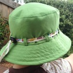 Green hat with trains
